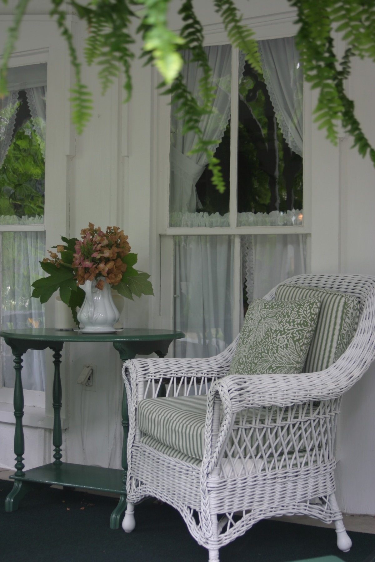 Green and white porch